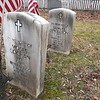 The markers honoring two fellow soldiers, with so much in common (see the gallery text)