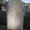 Humphrey's badly eroded gravestone.