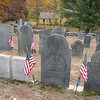Grave of William Scott, Jr. is flanked by flags in the center of this photo