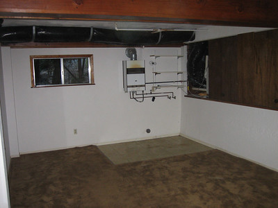 Bonus room (downstairs). Laundry goes where tile is.