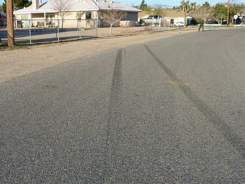 Skid marks from car that ran into fence