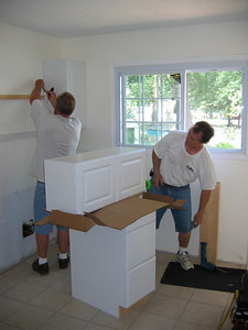 Jay & his Dad putting up the first cabinet.