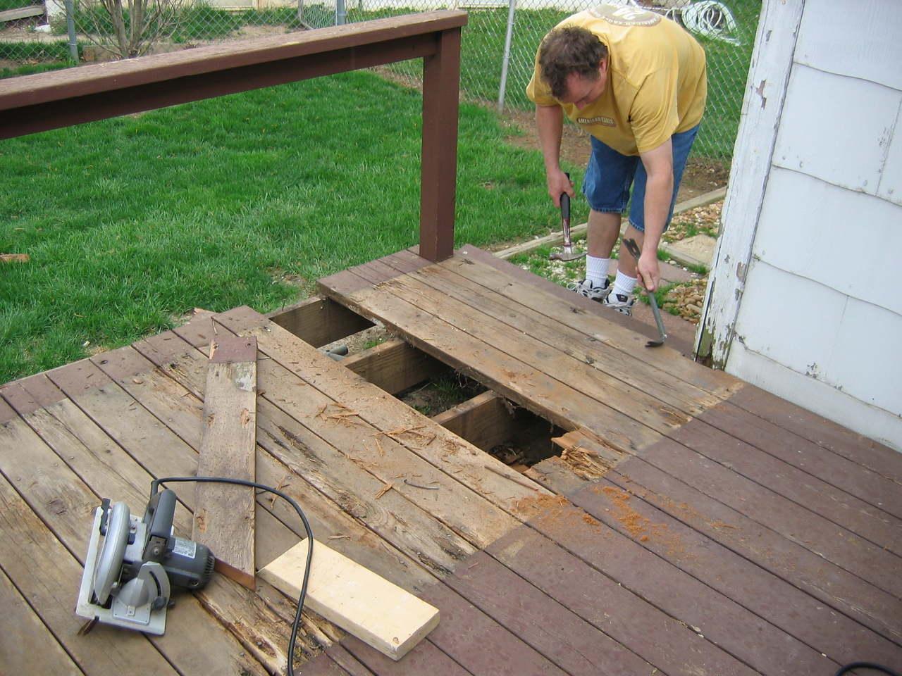 DECK Damage to deck after tenant layed a piece of plywood down to serve as a roof for cats living beneath!