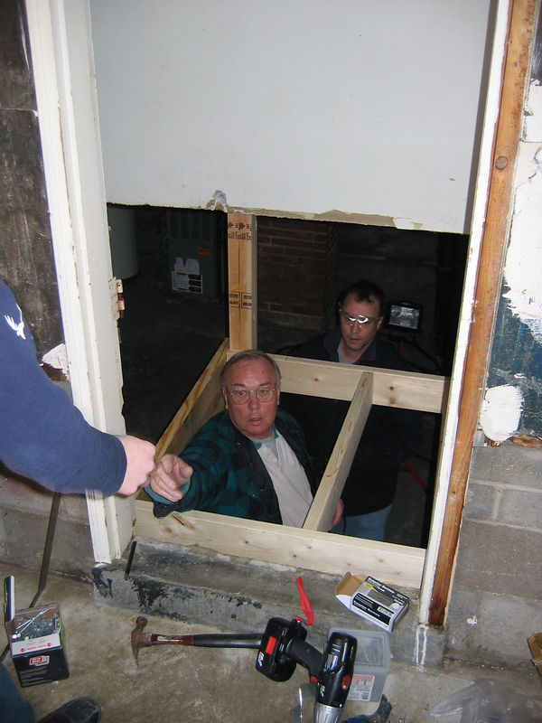 STAIRWELL. Down in the hole. Jay's Dad helps build a nice, new one.