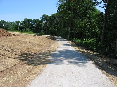 Long View of going down Bike Trail that runs behind our lot along the tree line July 04