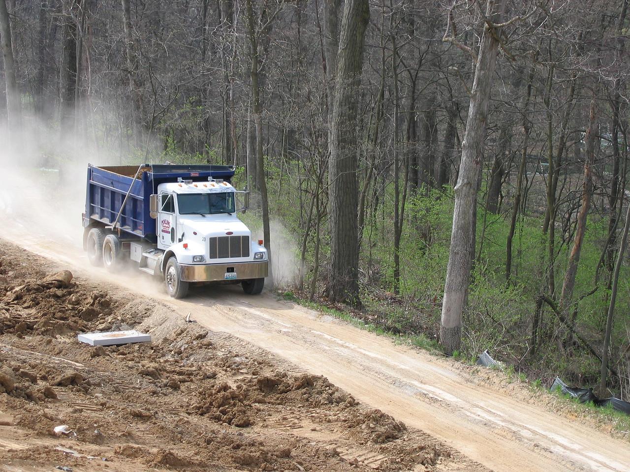 Truck Bringing in Fill Dirt down Bike Trail April 5