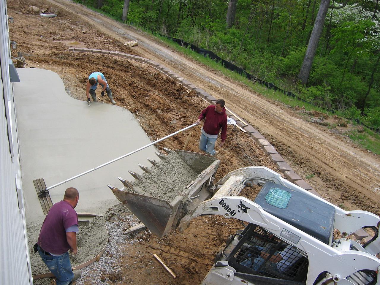 Concrete Brought Out Back via Bobcat April 27