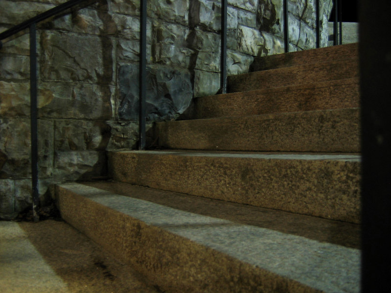 Stairs to the basement of Griffin Hall, Williamstown, MA, at night.