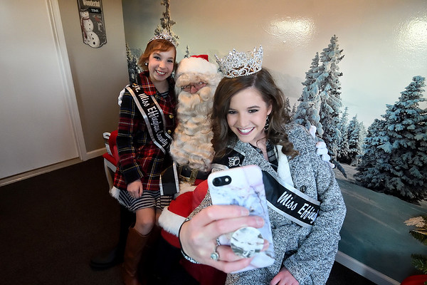 2017 Miss Effingham County Fair Queen Maria Lueken takes a selfie with Junior Miss Elizabeth Weidner and Santa Saturday evening during Hometown Christmas sponsored by the Downtown Effingham Business Group. Chet Piotrowski Jr. photo/Piotrowski Studios