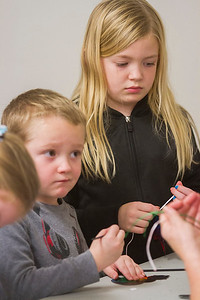 Luke and Lydia Wohltman complete Christmas crafts Saturday evening in the County Office Building. Keith Stewart Photo