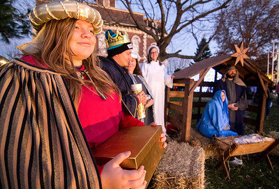 Kayla Packer stands as one of the three wise men during Saturday's live Nativity scene staged by members of the Cornerstone Christian Church. Keith Stewart Photo