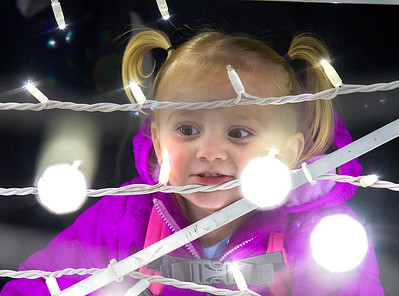 One-year-old Jaccie Pospischel admires one of the new light displays Saturday evening. Not only does she have Christmas to look forward to, but Pospischel will also turn two on Christmas Eve. Keith Stewart Photo
