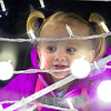 One-year-old Jaccie Pospischel admires one of the new light displays Saturday evening. Not only does she have Christmas to look forward to, but Pospischel will also turn two on Christmas Eve.<br /> Keith Stewart Photo