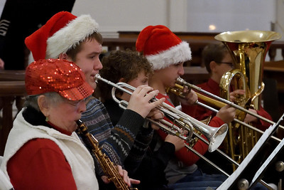 FACE Orchestra members perform Christmas carols inside the Effingham County Courthouse Museum Saturday during Hometown Christmas sponsored by the Downtown Effingham Business Group. Chet Piotrowski Jr. photo/Piotrowski Studios