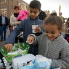 Five-year-old Amaya Griffiths, right, and her 9-year-old brother Keenan grab marshmallows for their hot chocolate Saturday at the Hometown Christmas in downtown Effingham.<br /> Keith Stewart Photo