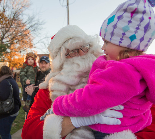 Santa Claus visits with 3-year-old Hannah Jansen Saturday evening in downtown Effingham.<br /> Keith Stewart Photo