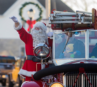 Santa Claus arrives in downtown Effingham on the old Caledonia fire truck Saturday as part of the annual Hometown Christmas held by the Downtown Effingham Business Group and Effingham County Chamber of Commerce. Keith Stewart Photo