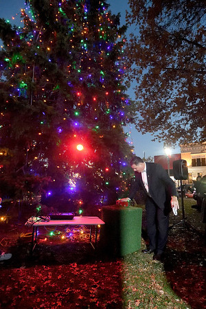 Effingham Mayor Jeff Bloemker lights the Christmas tree Saturday evening during Hometown Christmas sponsored by the Downtown Effingham Business Group and Effingham County Chamber of Commerce.<br /> Chet Piotrowski Jr. photo/Piotrowski Studios