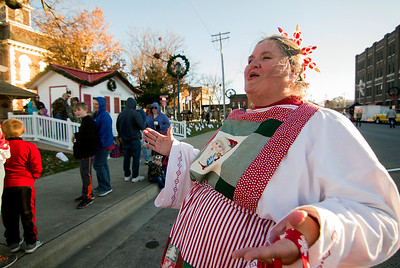 """Patty Winn, also known as Peppermint Patty, sings """"Jingle Bells"""" while people stand in line early waiting for Santa Claus to arrive Saturday in downtown Effingham. Keith Stewart Photo"""