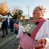 "Patty Winn, also known as Peppermint Patty, sings ""Jingle Bells"" while people stand in line early waiting for Santa Claus to arrive Saturday in downtown Effingham.<br /> Keith Stewart Photo"