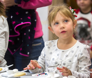 Five-year-old Maggie Shepard finishes her cookie decorating Saturday in the County Office Building as part of the annual Hometown Christmas which was sponsored by the Downtown Effingham Business Group and Effingham County Chamber of Commerce. Keith Stewart Photo