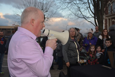 Jon Schafer calls the first group of 25 to stand in line for a visit with Santa Claus, shortly after he arrived at his house. Dawn Schabbing photo