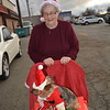 Betty Ramirez pushes her Yorkie, named Baby, in the parade. While she wore a santa hat, the dog had a Santa suit on for the event. Dawn Schabbing photo