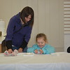 Kristina Richards with Kalea Richards, 4, of Beecher City, decorate a cookie during Hometown Christmas on Saturday. Dawn Schabbing photo