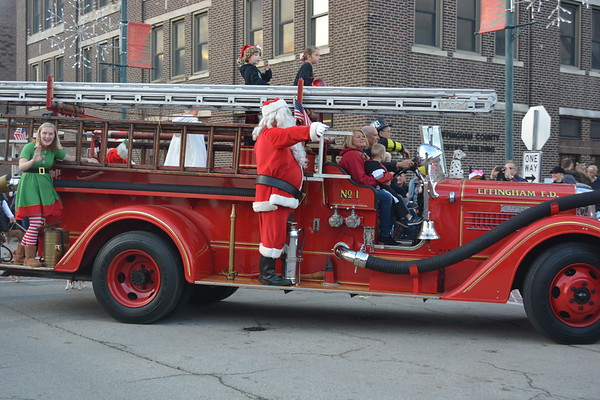 Santa arrives by fire truck to his house downtown.  Dawn Schabbing photo