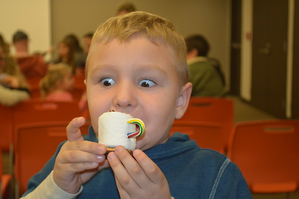 Jasper Everett, 6, is about to sink his teeth into an edible craft make and take, cup of hot chocolate, at the Effingham Public Library. He is the son of Chelsea Munoz. Dawn Schabbing photo.