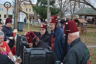 Effingham Shriners served up hot chocolate and cookies for a free will donation during the Hometown Christmas event. Dawn Schabbing photo