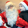 Callen Jacobs, 4, of Savoy tells Santa a list of items he would to receive on Christmas Saturday evening during Hometown Christmas sponsored by the Downtown Effingham Business Group.<br /> <br /> Chet Piotrowski Jr. photo/Piotrowski Studios