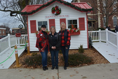 Members of the Downtown Effingham Business Group who led the way organizing the Hometown Christmas event from left to right are Lisa Schafer, Sandy Lewis, and Lori Worman.  Dawn Schabbing photo