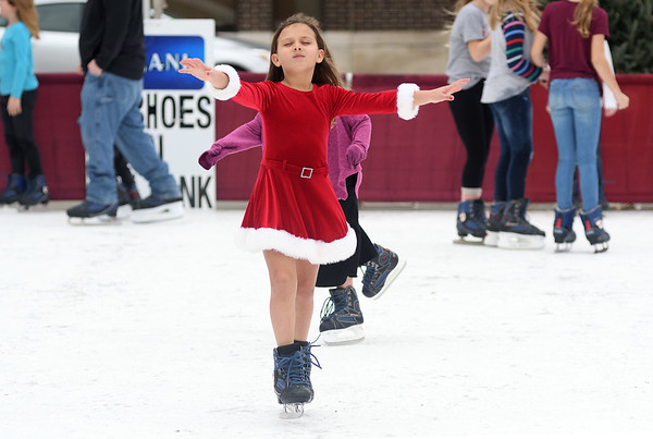 Alivia Blomberg, 7, of Farina skates Saturday afternoon during the Hometown Christmas in downtown Effingham sponsored by the Downtown Effingham Business Group.<br /> <br /> Chet Piotrowski Jr. photo/Piotrowski Studios