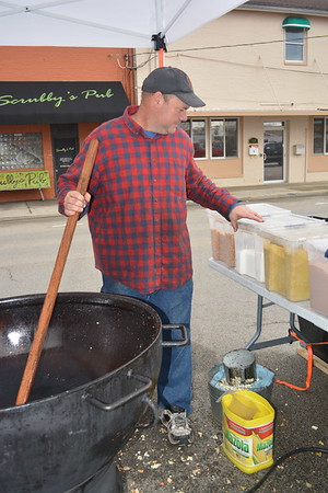 Jay Macklin of Mason with Macklin Meadow Kettle Corn stirs another batch during the Hometown Christmas event. Dawn Schabbing photo