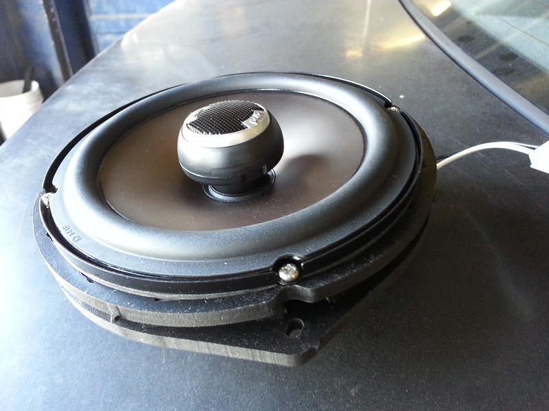 "Aftermarket speaker mounted to speaker adapter rings from  <a href=""http://www.car-speaker-adapters.com/items.php?id=SAK033""> Car-Speaker-Adapters.com</a>   .  Wiring harness installed."