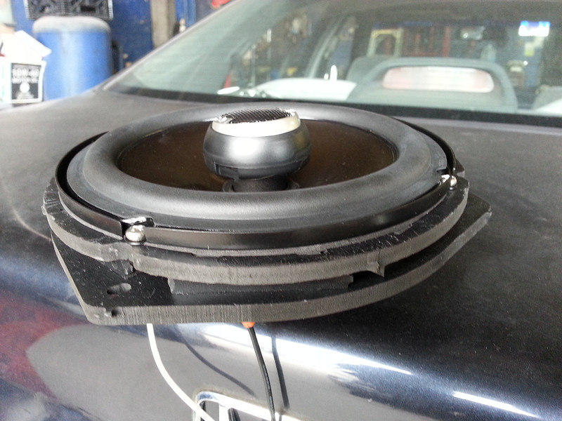 "Aftermarket speaker mounted to speaker adapter ring from  <a href=""http://www.car-speaker-adapters.com/items.php?id=SAK033""> Car-Speaker-Adapters.com</a>   .  Wiring harness installed."
