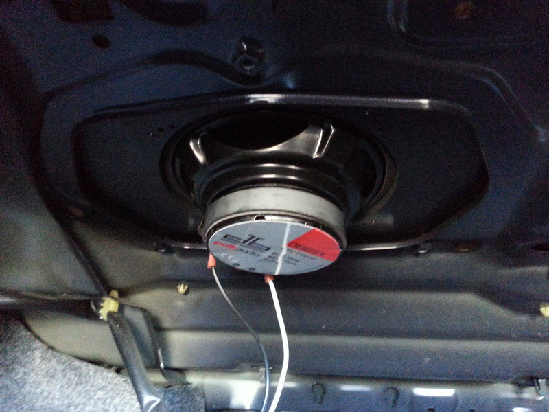 """Aftermarket speaker and speaker adapter plate  from  <a href=""""http://www.car-speaker-adapters.com/items.php?id=SAK030""""> Car-Speaker-Adapters.com</a>  installed (trunk view)"""