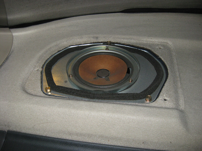 Grill removed.  Factory speaker and speaker adapter shown.