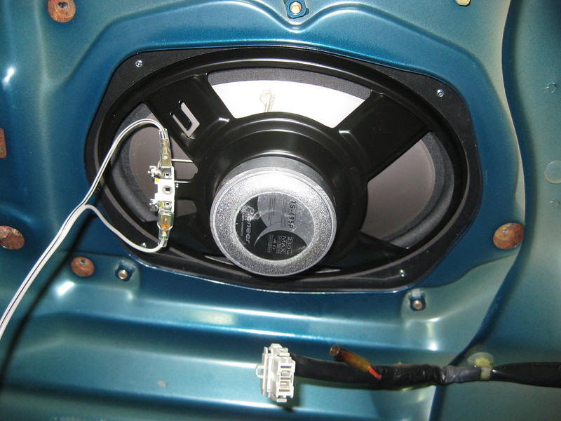 """Aftermarket speaker and  speaker adapter  from  <a href=""""http://www.car-speaker-adapters.com/items.php?id=SAK030""""> Car-Speaker-Adapters.com</a>   installed in rear deck (trunk view)"""