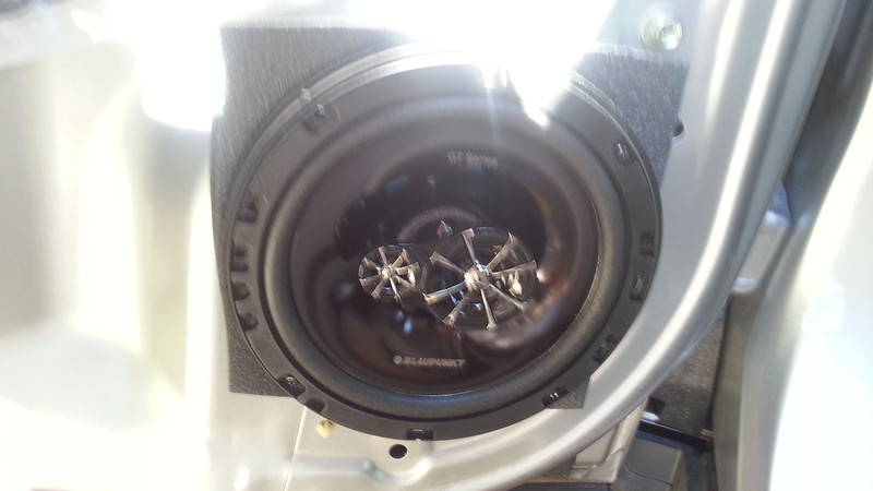 "Aftermarket speaker, foam speaker baffle, and speaker adapter ring   from  <a href=""http://www.car-speaker-adapters.com/items.php?id=SAK094""> Car-Speaker-Adapters.com</a>   installed on door"