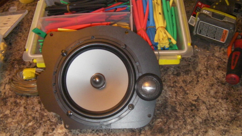 Close view of component speakers and speaker adapter assembly.