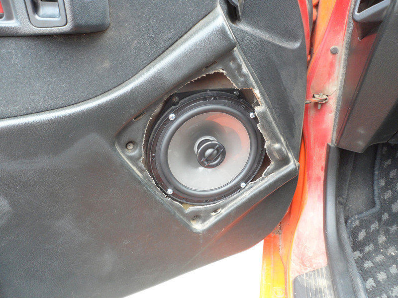 "Aftermarket speaker and speaker adapter bracket  from  <a href=""http://www.car-speaker-adapters.com/items.php?id=SAK033""> Car-Speaker-Adapters.com</a>   Installed on door.  Door panel reinstalled."