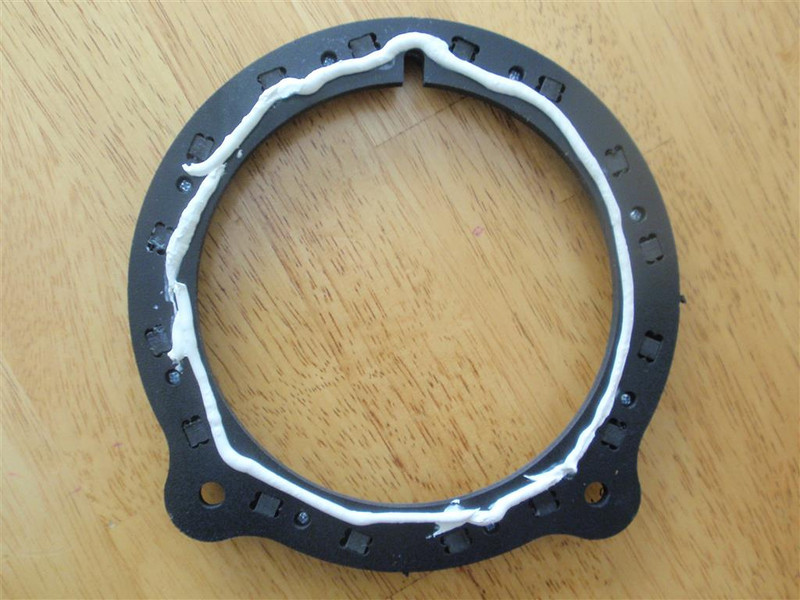 """Sealant applied to rear of speaker adapter bracket    from  <a href=""""http://www.car-speaker-adapters.com/items.php?id=SAK028""""> Car-Speaker-Adapters.com</a>"""