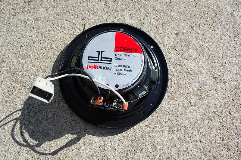 Aftermarket speaker with wiring plug installed