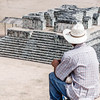 Man looking over mayan ruins at the Copan Archaeological Park in Honduras.
