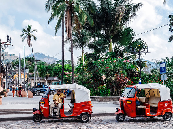 Tuk-tuk taxis waiting by Parque Central in Copan Ruinas, Honduras.