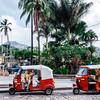 Tuk-tuk taxis waiting by Parque Central in Copan Ruinas, Honduras.