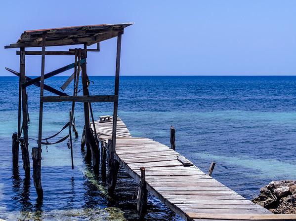 Crooked dock in the ocean in Utila, Honduras.
