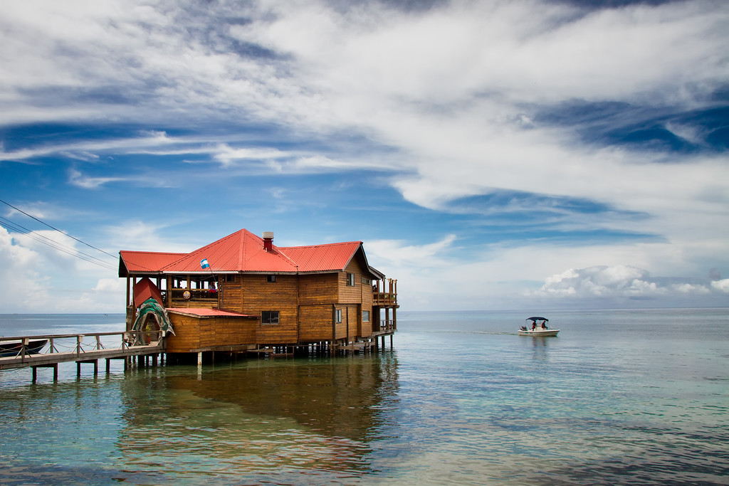 Blue Sky, Red Roof, Clear Water